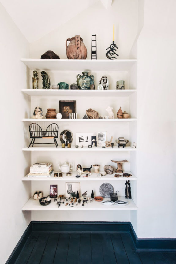 white built-in bookcase styled with art objects. / sfgirlbybay