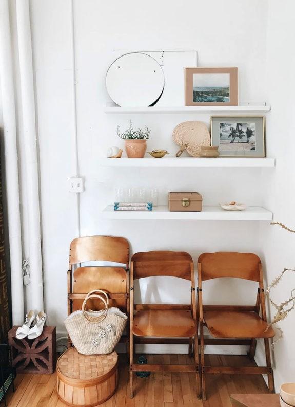 floating white shelves over folding wood chairs. / sfgirlbybay