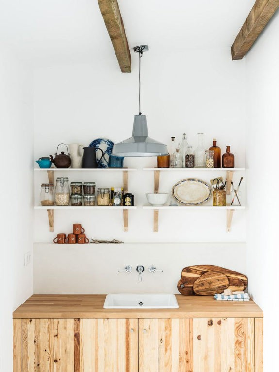 simple ikea shelving with kitchen goods over wood cabinet with sink. / sfgirlbybay