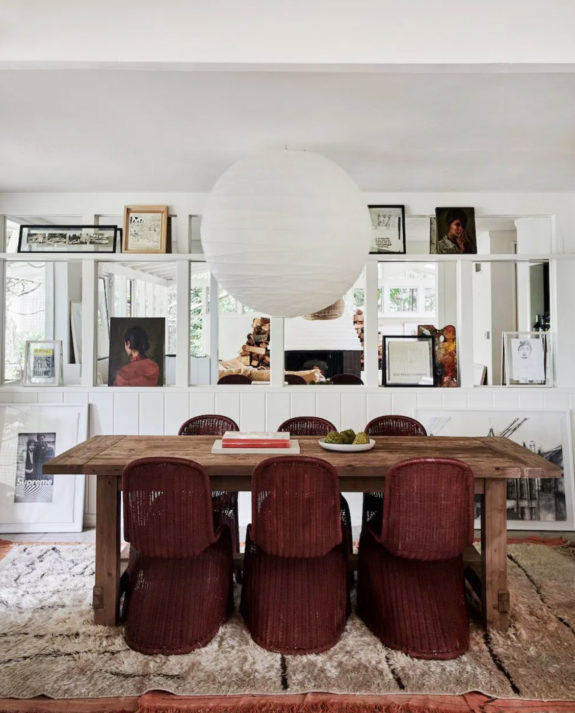vintage modern dining room with mirrored wall and picture rail. / sfgirlbybay