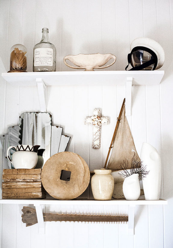 open white shelves with curated vintage decor. / sfgirlbybay
