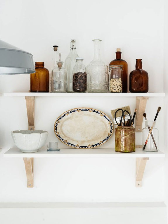 small white shelves with wood brackets. / sfgirlbybay