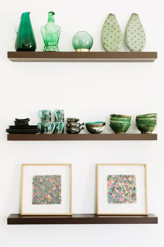 green ceramics, glassware and cactus paddles on simple wood shelves. / sfgirlbybay